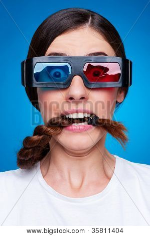 frightened woman in 3d glasses watching blockbuster