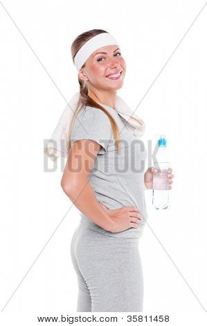happy sportswoman with towel and bottle of water. studio shot over white background