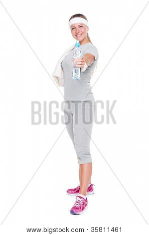young fitness woman holding bottle of water and smiling over white background