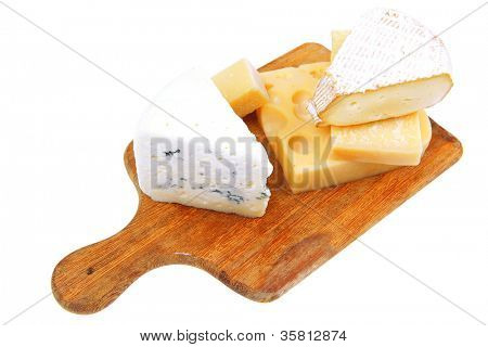 various types of solid french cheese parmesan brie and edam on wooden platter isolated on white background