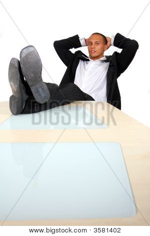 Businessman With Feet On The Table