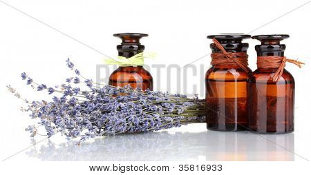 Lavender flowers and glass bottles isolated on white