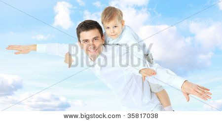Father holding son on his shoulders