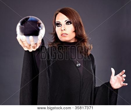 Woman holding crystal ball. Fortune telling.