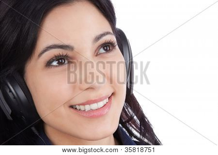 Close-up of woman listening music on headphone isolated on white background.