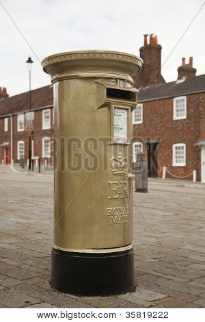 HAMBLE, NR SOUTHAMPTON, UK - AUG 8:UK's Royal Mail honors Olympic Gold Medal winners, by transforming a post box from red to gold in the home town of each gold medalist on Aug 8,2012 in Hamble, UK.