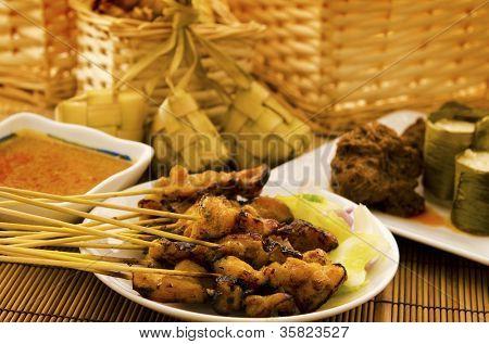 Asian malay Ramadhan foods, satay chicken, rendang, lemang and ketupat