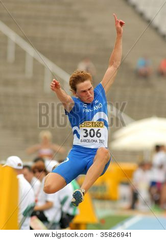 BARCELONA - JULY, 10: Juuso Hassi of Finland during Long Jump Decathlon event of the 20th World Junior Athletics Championships at the Olympic Stadium on July 10, 2012 in Barcelona, Spain