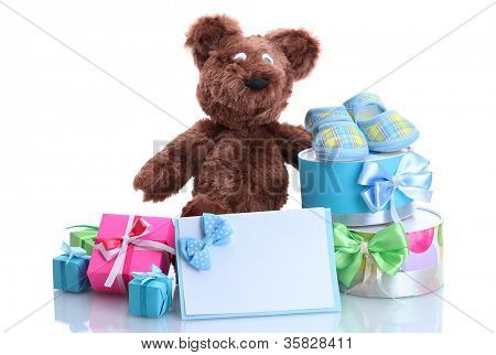 beautiful gifts, baby's bootees and bear toy  isolated on white