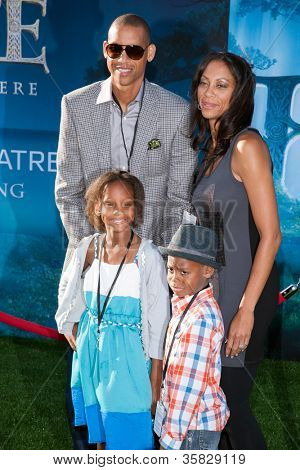 HOLLYWOOD, CA - JUNE 18: Basketball great, Reggie Miller and family arrive at the Los Angeles Film Festival premiere of 'Brave' at Dolby Theatre on June 18, 2012 in Hollywood, California.