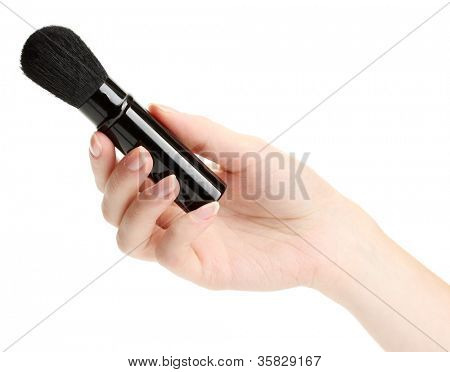 hand with black brush for make-up  isolated on white