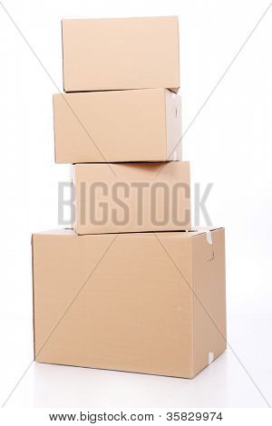 Pile of cardboard boxes over white background