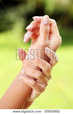 Woman washing her beautiful hands