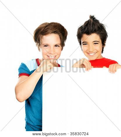 Two happy boys isolated on white background, cute male classmates hold white blank class board, group of teenager playing in classroom, best friends enjoying education at school, back to school
