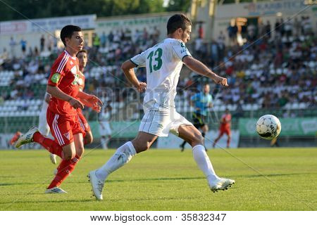 KAPOSVAR, HUNGARY - AUGUST 4: Drazen Okuka (in white) in action at a Hungarian National Championship soccer game Kaposvar (white) vs Debrecen (red) on August 4, 2012 in Kaposvar, Hungary