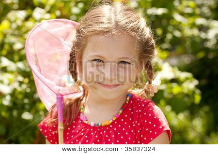 Smiling Girl With A Butterfly Net