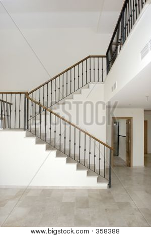 Interior Of Large Hallway In Spanish Villa With Big Two Tier Sta