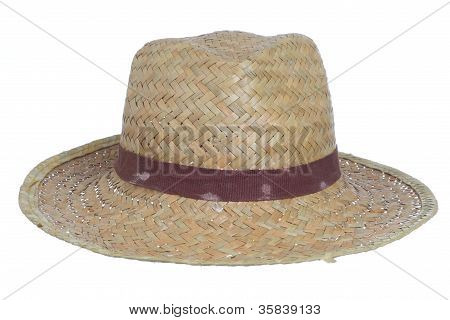 dirty old straw hat isolated on a white background