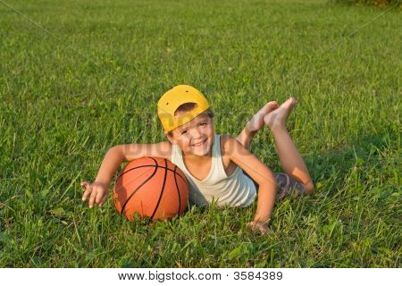 Boy With Basketball Outdoors