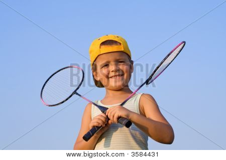 Boy With Badminton Rackets