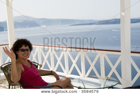 Tourist Relaxing In Santorini