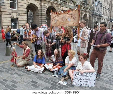 EDINBURGH- AUGUST 11: Members of Lancaster Offshoots publicize their show Trojan Women during Edinburgh Fringe Festival on August 11, 2012 in Edinburgh