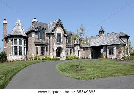 Large suburban brick and stone home with circular driveway