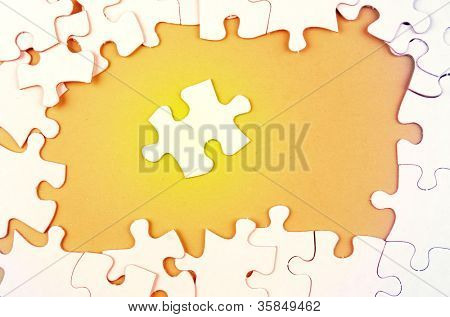 Jigsaw puzzle pieces, one apart