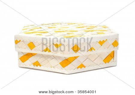 closeup of a basketwork box on a white background