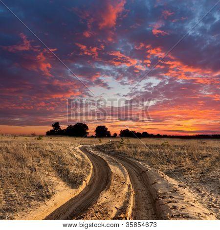 path on sandy steppe on sunset