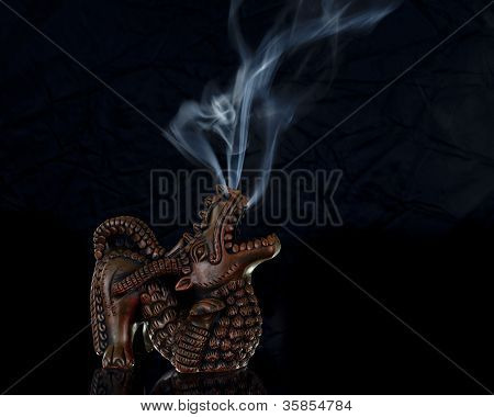 Craved Dragon Incense Burner Burning with Smoke Rising Out of the Nose and Mouth