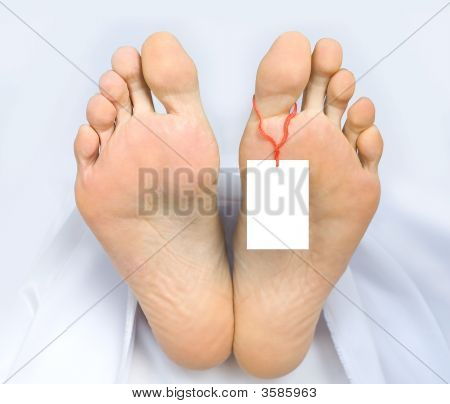 Two Feet Of A Dead Body, With Blank Sign