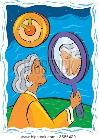 Senior Woman Looking At Herself In A Hand Mirror