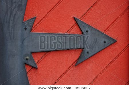 Black Arrow On Red