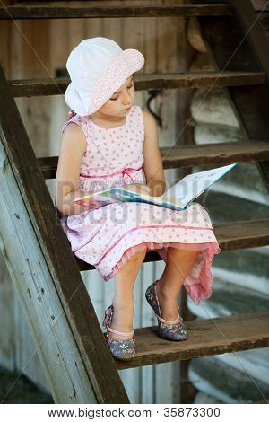 Pretty Girl Is Reading A Children's Book