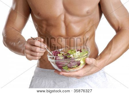 Shaped and healthy body man holding a fresh salad bowl,shaped abdominal,