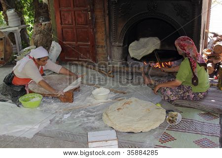 Turkish ladies making bread