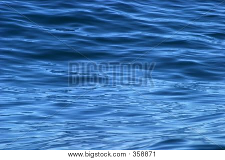 Beautiful Calm Ripples On Deep Blue Ocean On A Bright Sunny Day