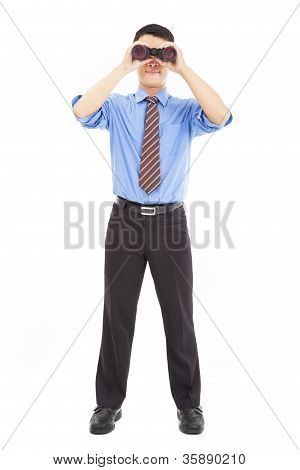 Full Length Of Businessman Looks Through Binoculars And Isolated On White