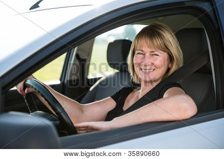 Portrait of senior woman in car