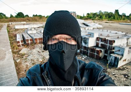 Concept Photo. Thief Takes Off Security Camera
