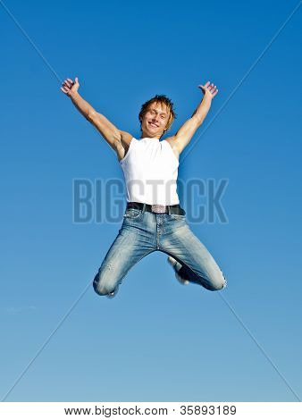 Happy Jumping Man On Blue Sky Background