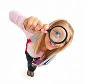 Back To School. Funny Schoolgirl Looking Through The Magnifying Glass.Isolated on White