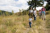 stock photo of extended family  - three generations of a family wandering together in the mountains