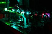 stock photo of diffraction  - Movement of microparticles by beams of laser in dark lab - JPG