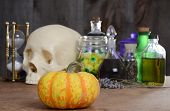 halloween still life with pumpkin and potions