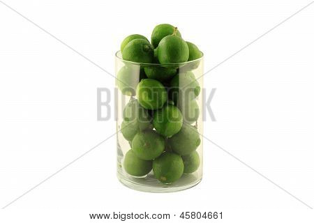 Key Limes In Glass Cylinder On White.