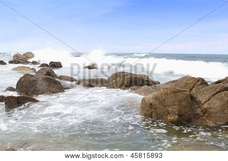 beautiful stones in the waves on ocean coast
