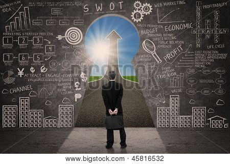 Businessman Look For Marketing Success Strategy Concept