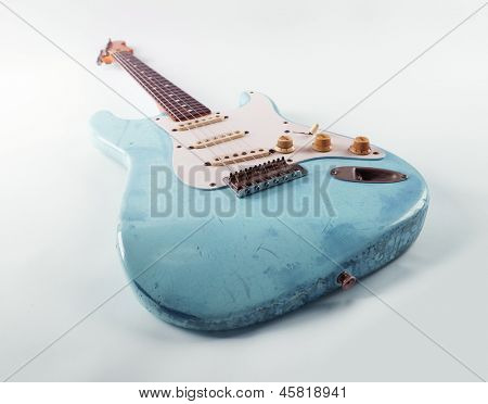 Vintage blue guitar with worn and battered nitro cellulose lacquer finish